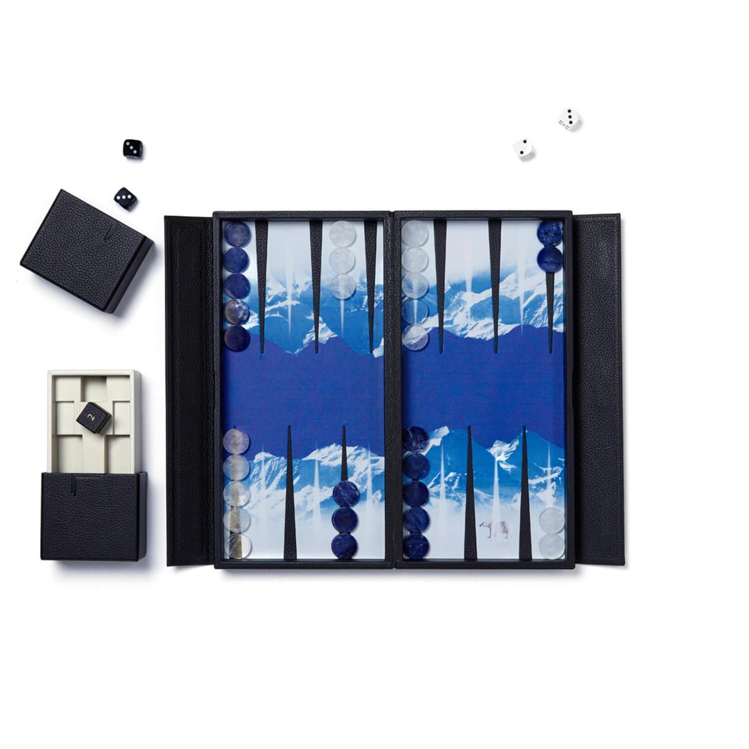 A glacier travel backgammon set with rock crystal and blue sodalite playing pieces
