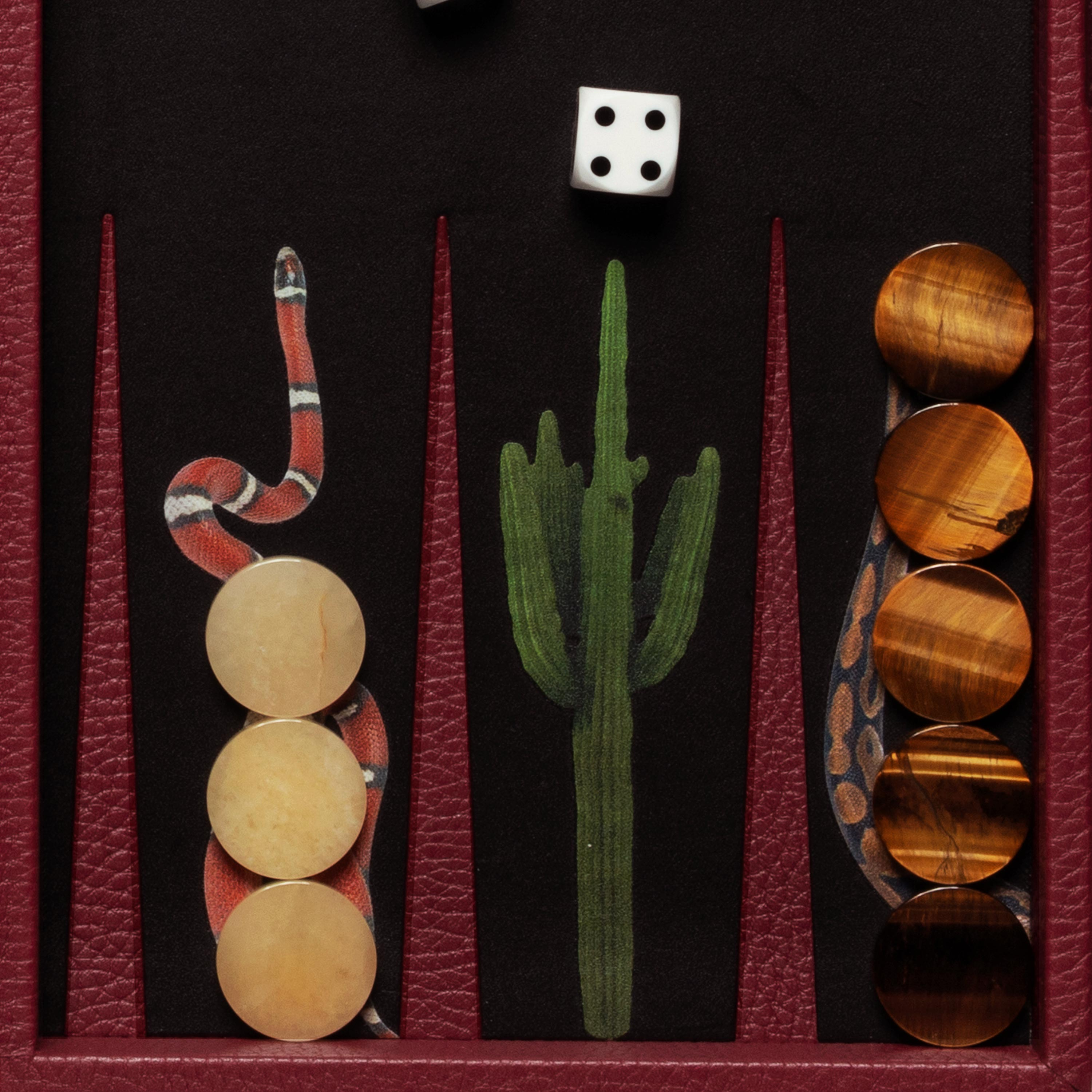 Semi-precious tiger's eye and yellow agate playing pieces on Snake travel snake backgammon set